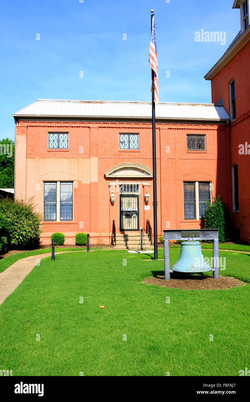 Liberty bell and flag outside the Helena city museum in Arkansas - Stock Image