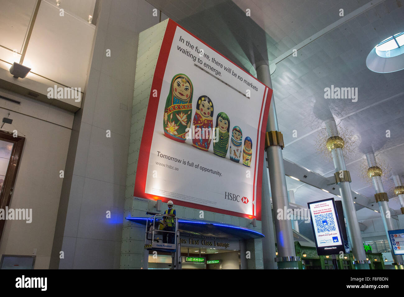 Emirates First Class entrance and HSBC advertisement Stock
