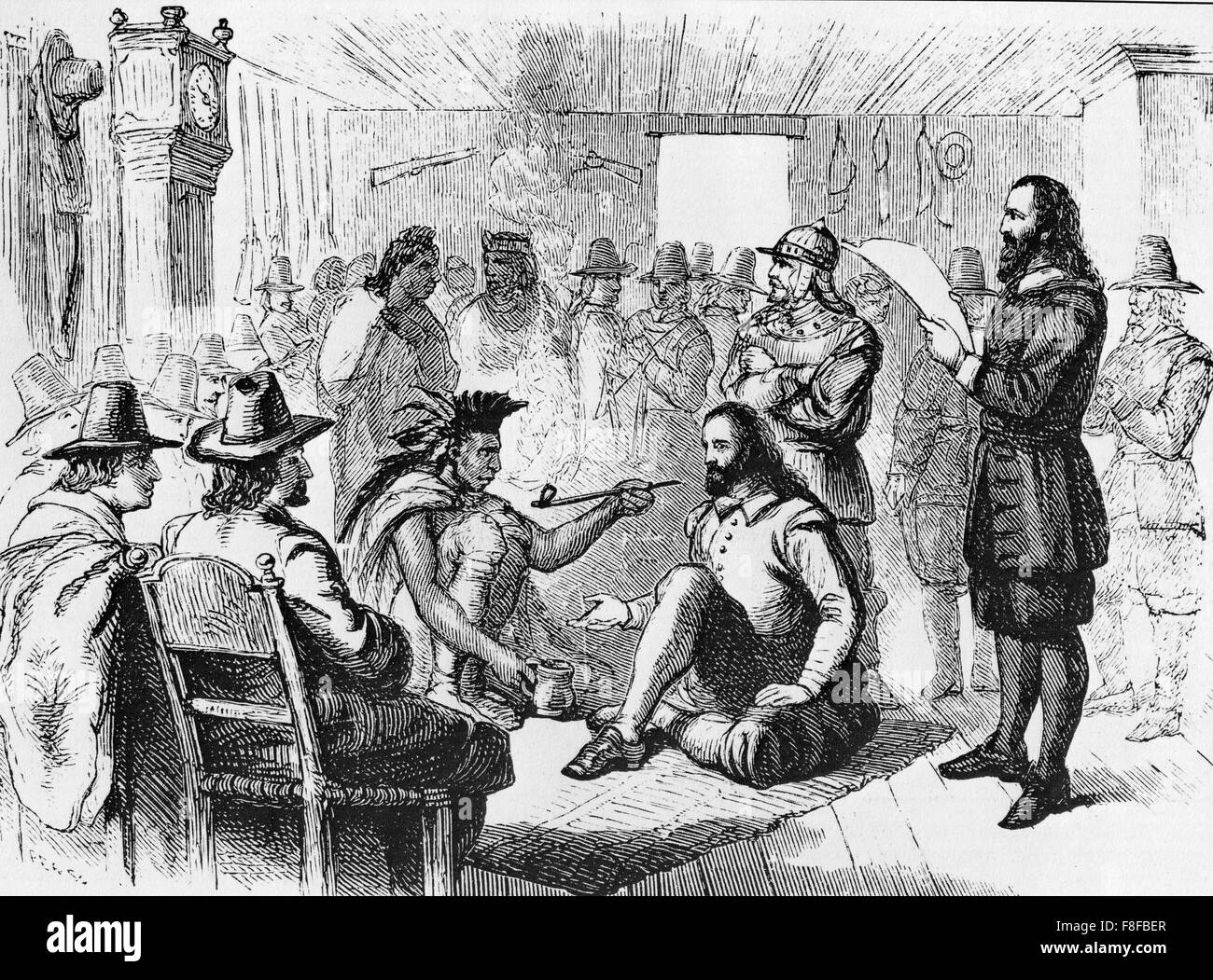 MASSASOIT SACHEM leader of the Wampanoag Native Americans smoking a ceremonial  pipe with Governor John Carver at - Stock Image