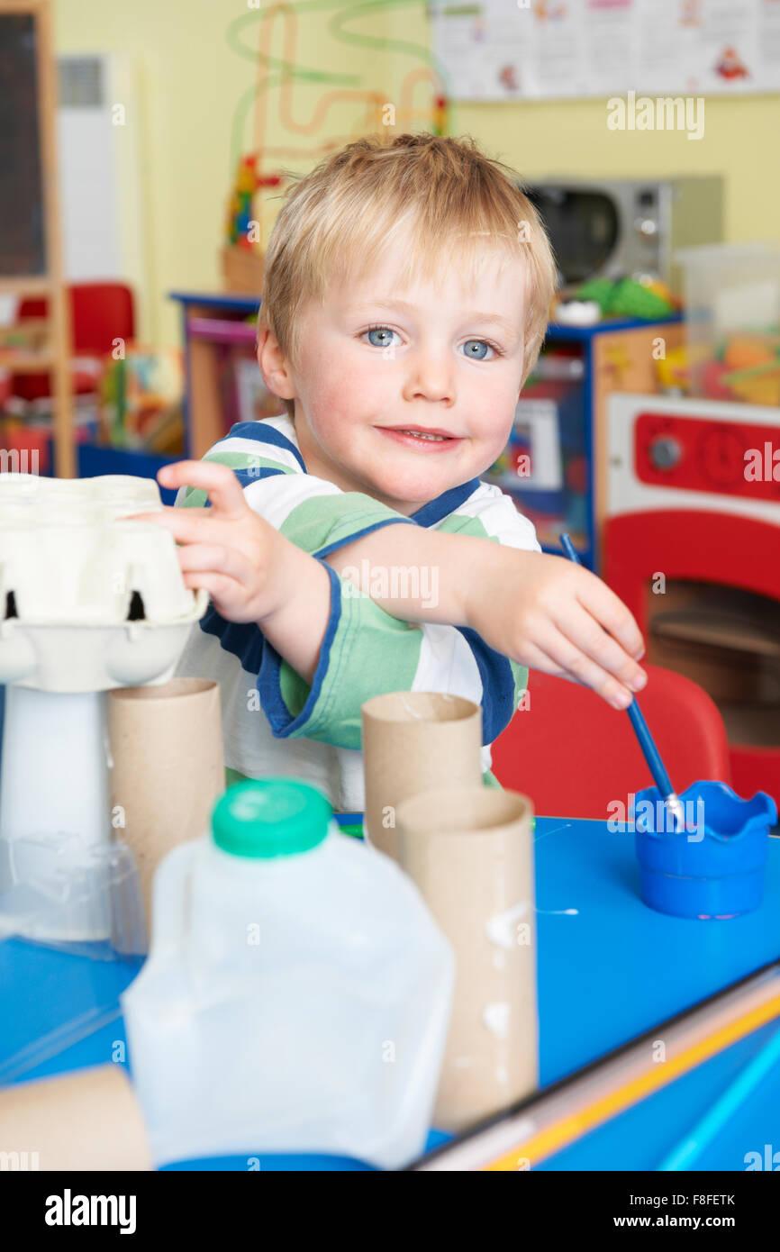Boy Building Junk Model In Pre School Class - Stock Image
