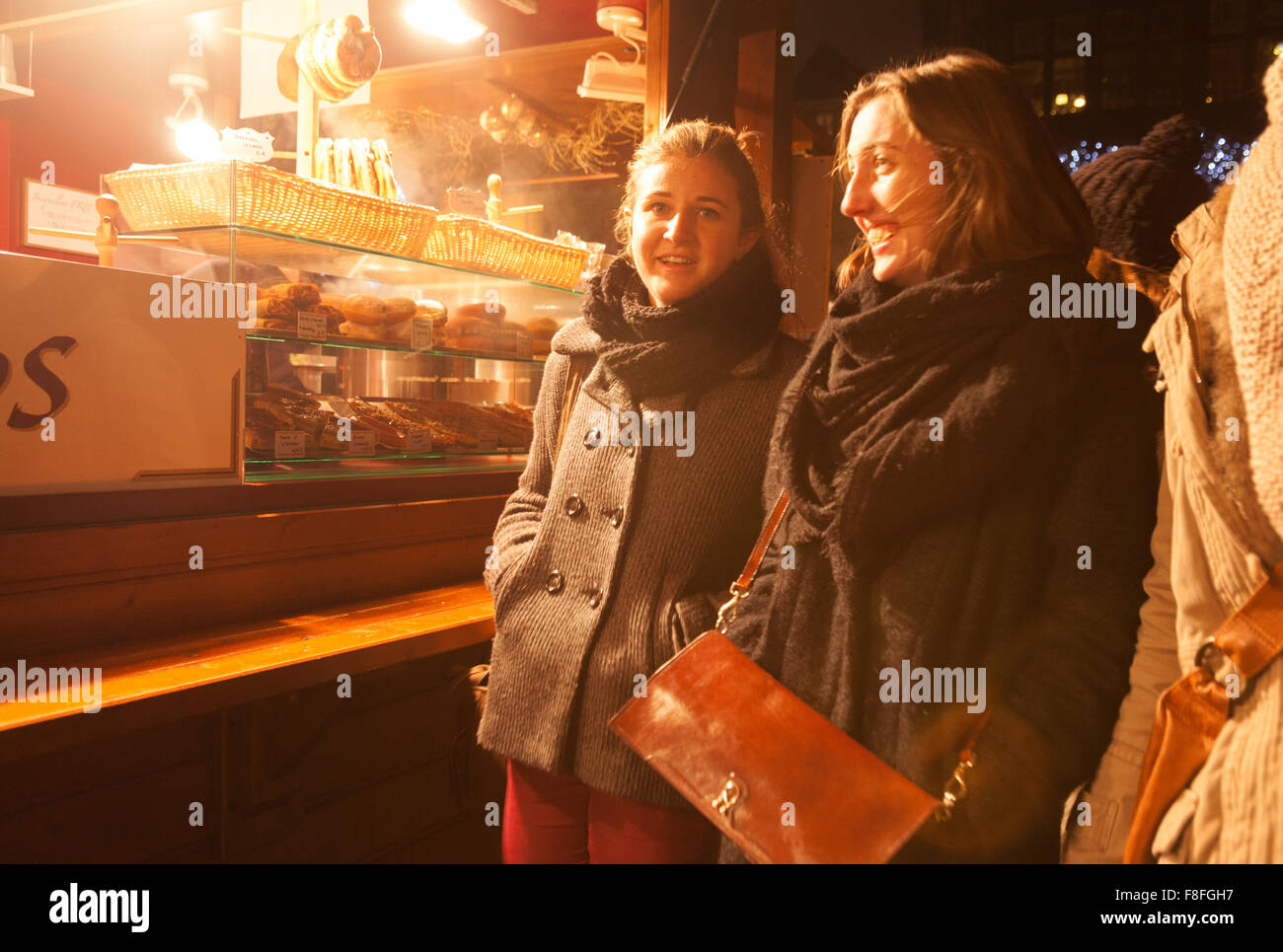 Women shopping and having fun, Strasbourg Christmas market, Strasbourg, Alsace, France Europe - Stock Image