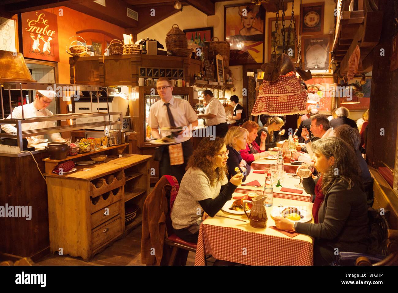 Strasbourg restaurant; people eating food inside Le Gruber restaurant, Rue du Maroquin, Strasbourg Old Town, Alsace Stock Photo