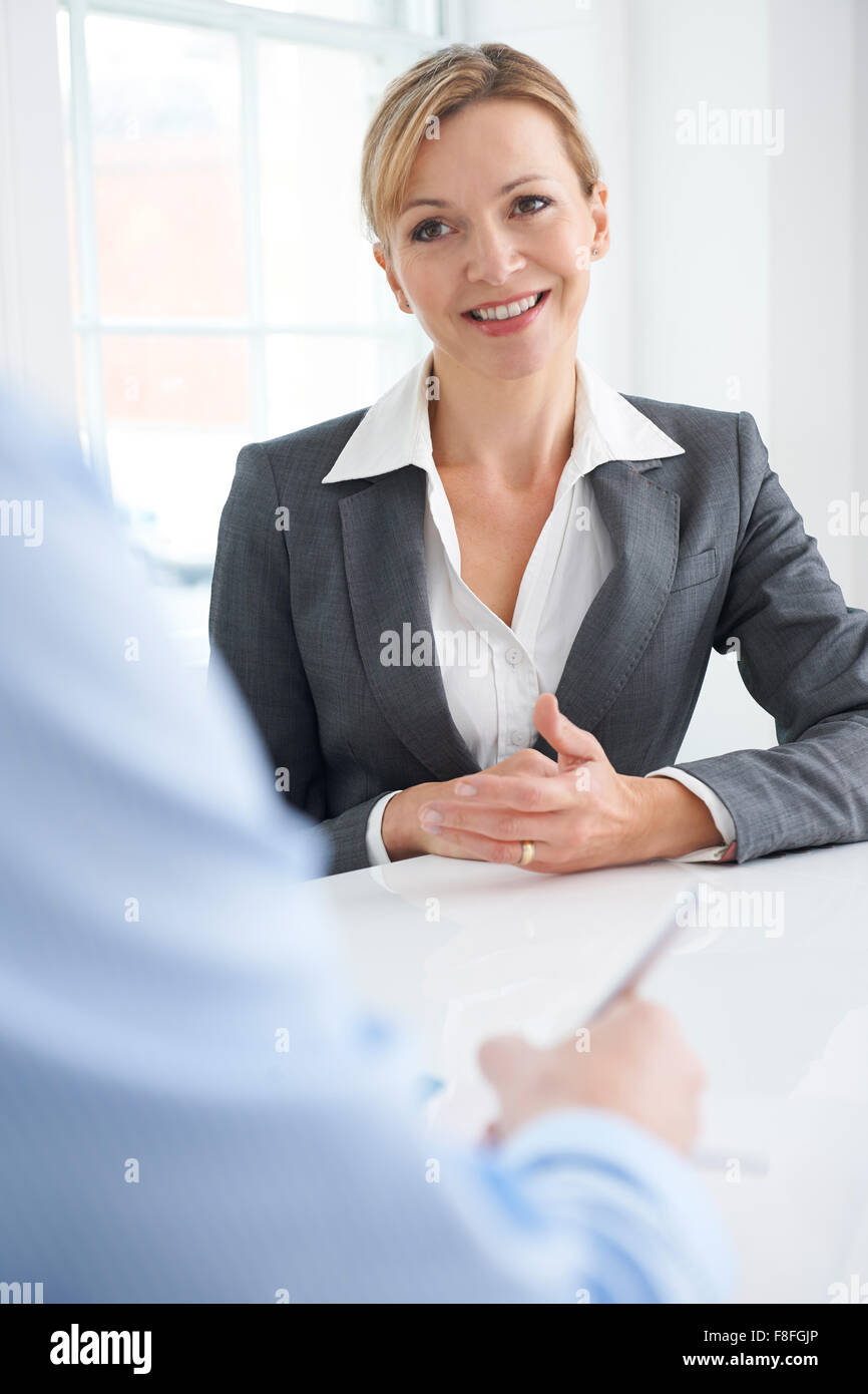 Businessman Interviewing Female Job Candidate - Stock Image