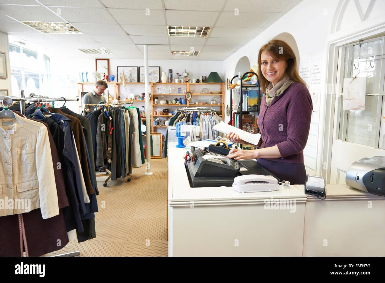 Volunteer Working In Charity Shop - Stock Image