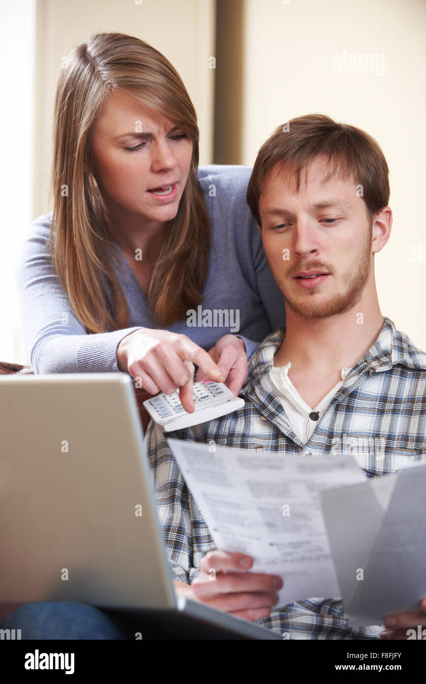 Couple Arguing Over Home Finances - Stock Image