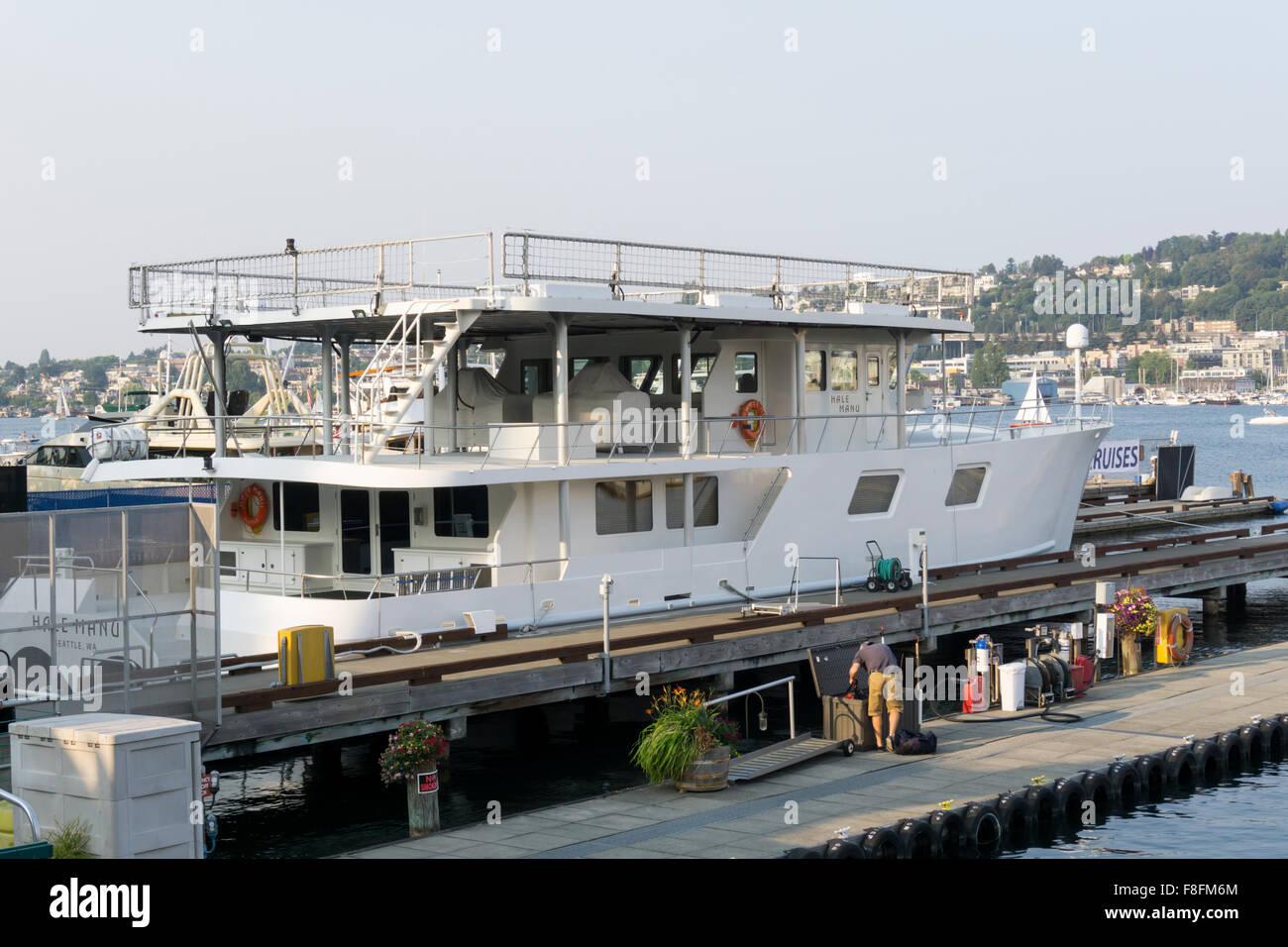 Bill Gates' floating heliport, the MV Hale Manu, moored in Seattle. - Stock Image