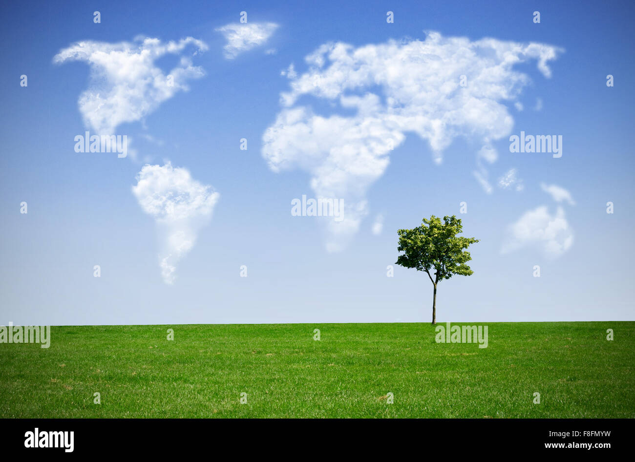 Clouds in the shape of a world map against blue sky - Stock Image