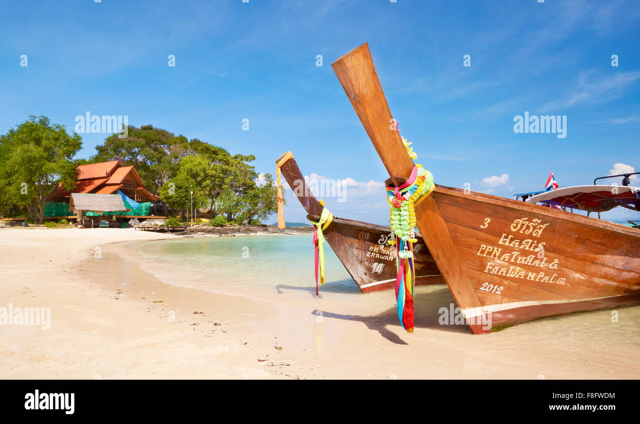 Thailand - Phi Phi Island, Phang Nga Bay, long tail boats - Stock Image