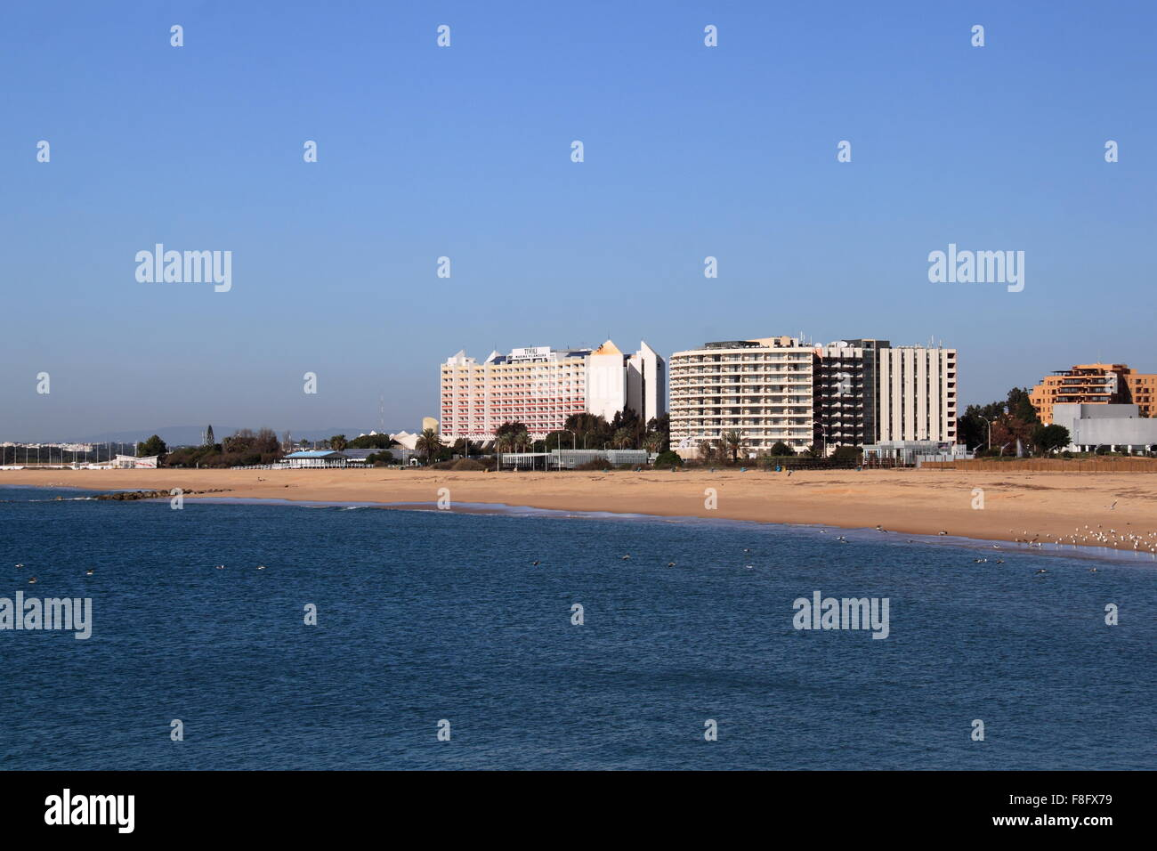Praia da Marina and Hotel Vila Galé Ampalius, with Tivoli Marina Hotel behind, Vilamoura, Quarteira, Algarve, Portugal, Stock Photo