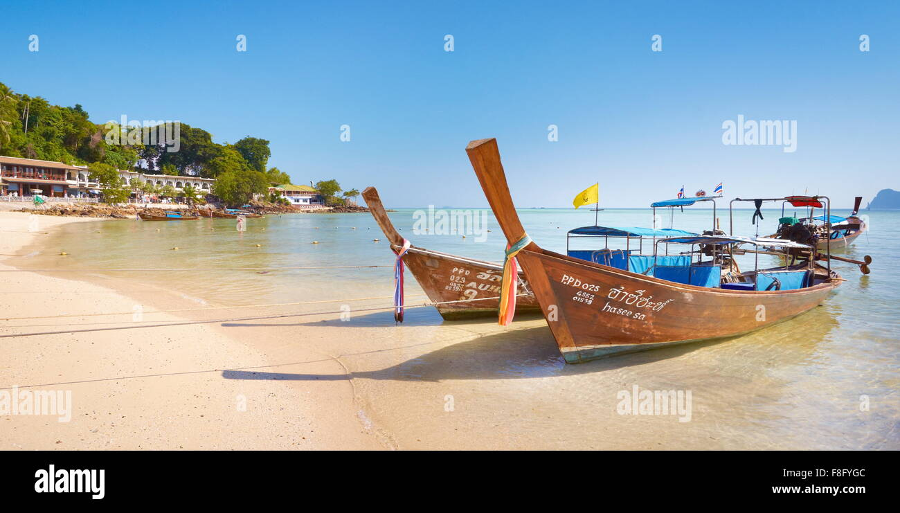 Thailand - Phi Phi Island, Phang Nga Bay, long tail boats on the beach - Stock Image