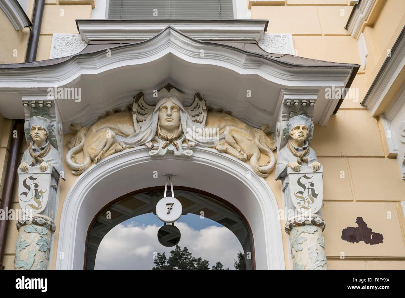 Real Estate, refurbished apartment house, entrance door with figures,  Victoria Luise Platz, Schoeneberg, Berlin - Stock Image