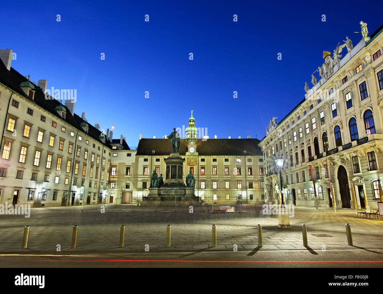 View of Hofburg (In der Burg courtyard), the imperial palace of the Habsburgs, from Michaelerplatz Vienna, Austria - Stock Image