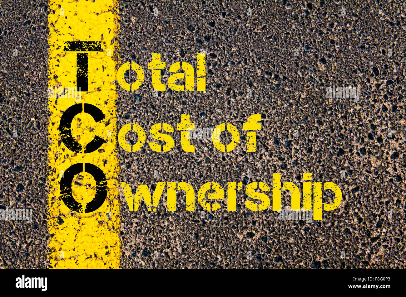 Concept image of Accounting Business Acronym TCO Total Cost of Ownership written over road marking yellow paint - Stock Image