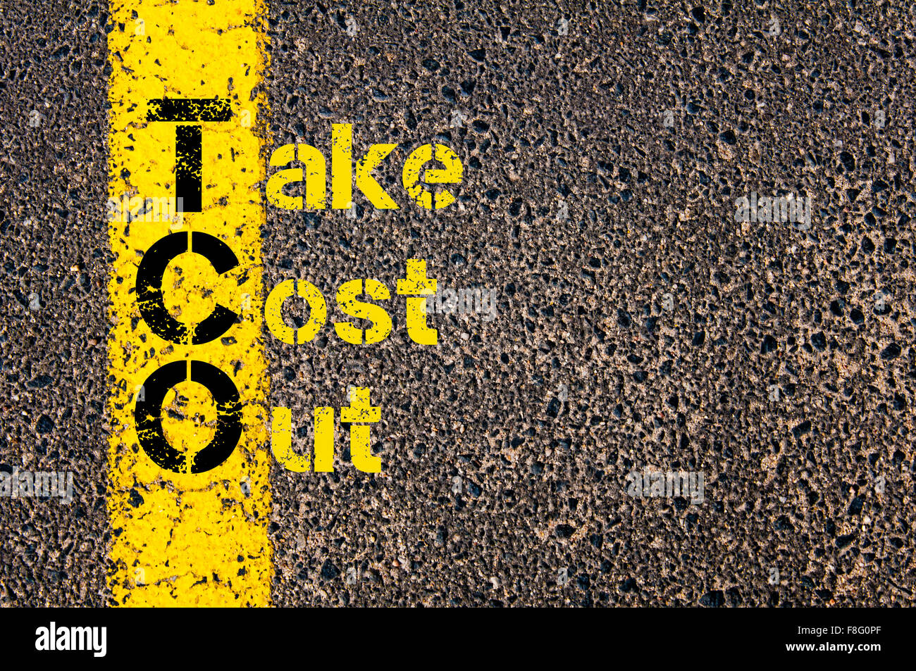 Concept image of Accounting Business Acronym TCO Take Cost Out written over road marking yellow paint line. Stock Photo