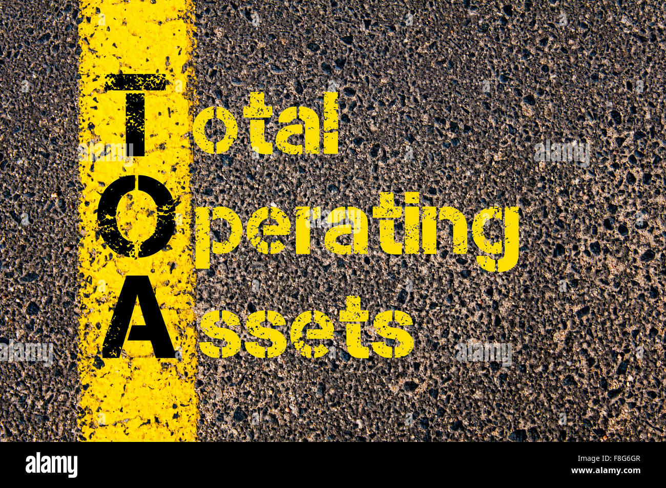 Concept image of Accounting Business Acronym TOA Total Operating Assets written over road marking yellow paint line. - Stock Image