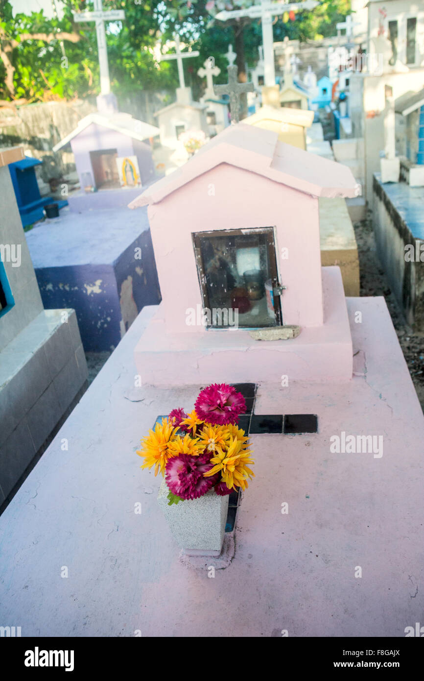 Flowers on a tomb in a Mexican cemetery Stock Photo