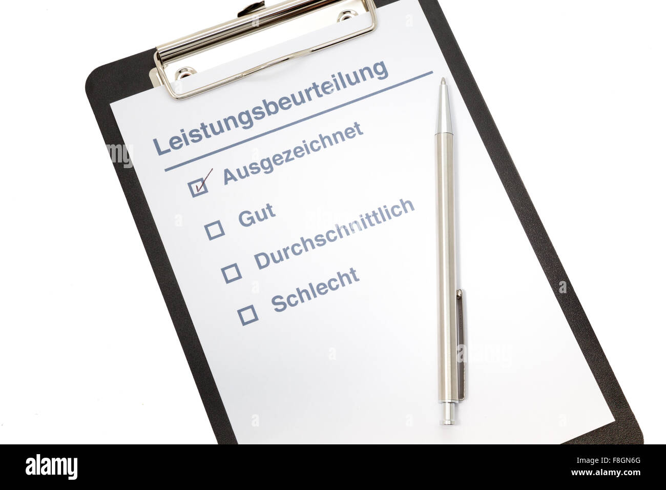 Performance evaluation paper with pen and tick marks on clipboard in german - Stock Image