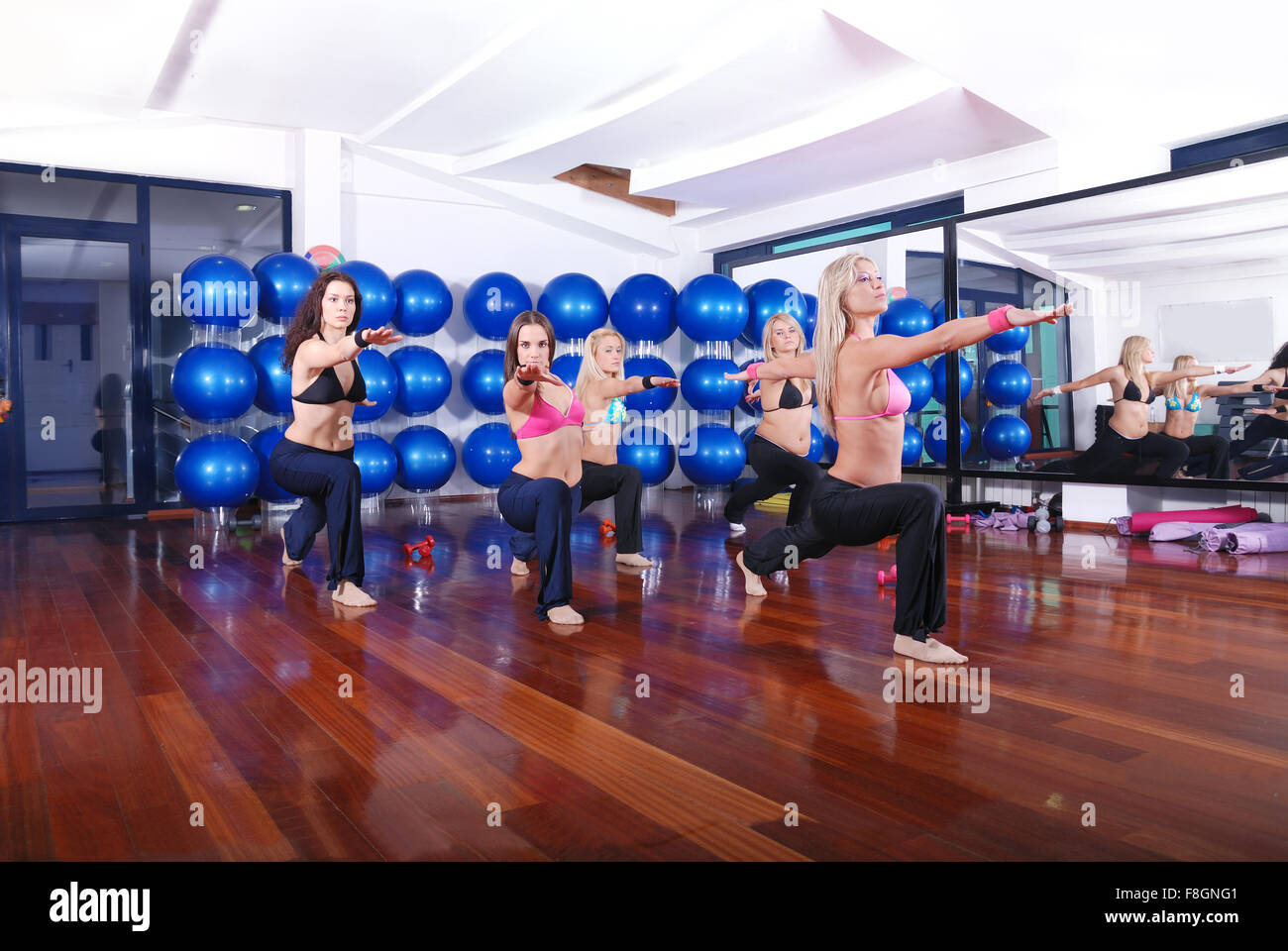 health club: women doing stretching, fitness, aerobics and