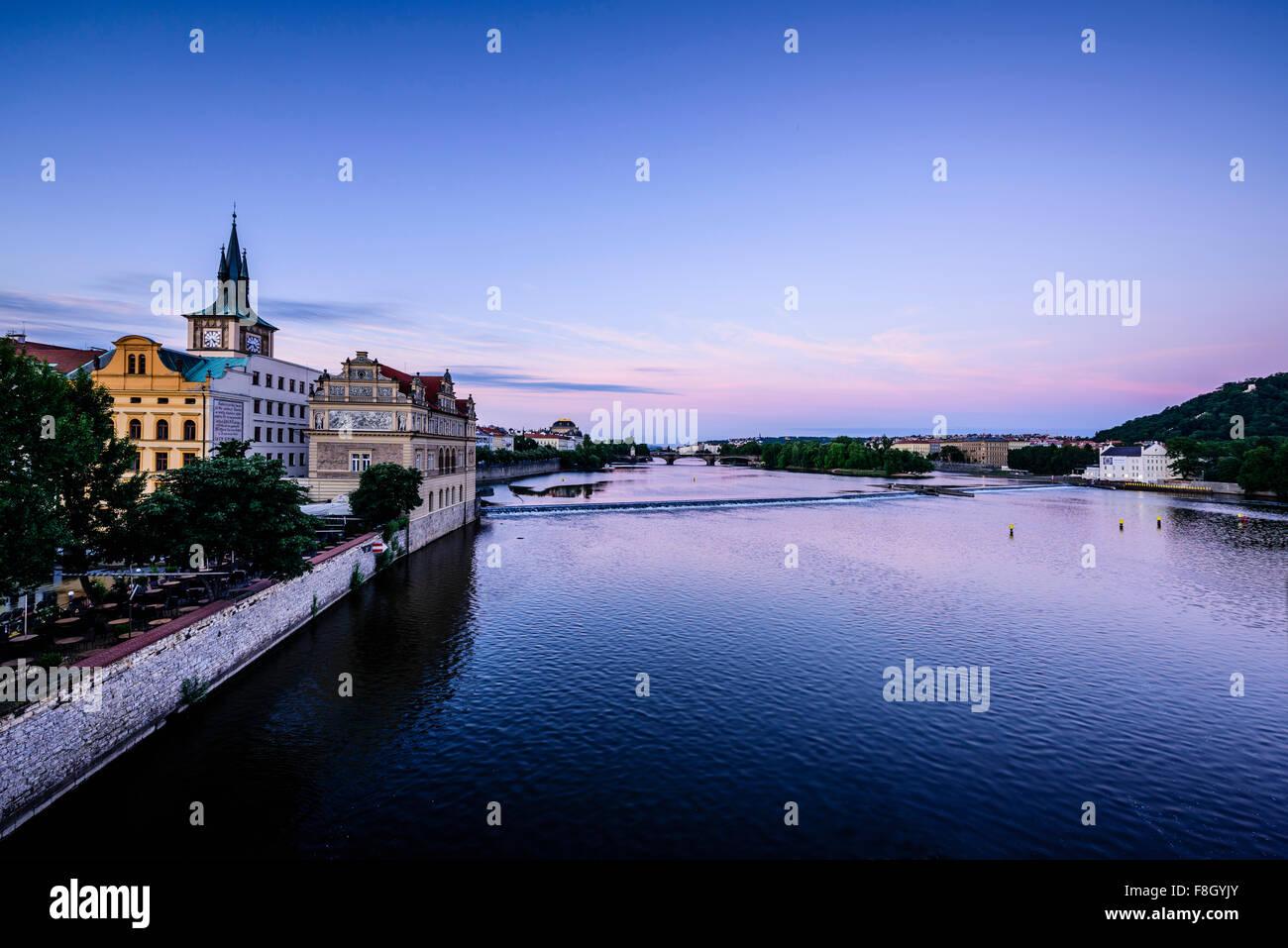 Blue sky over Prague waterfront, Czech Republic - Stock Image