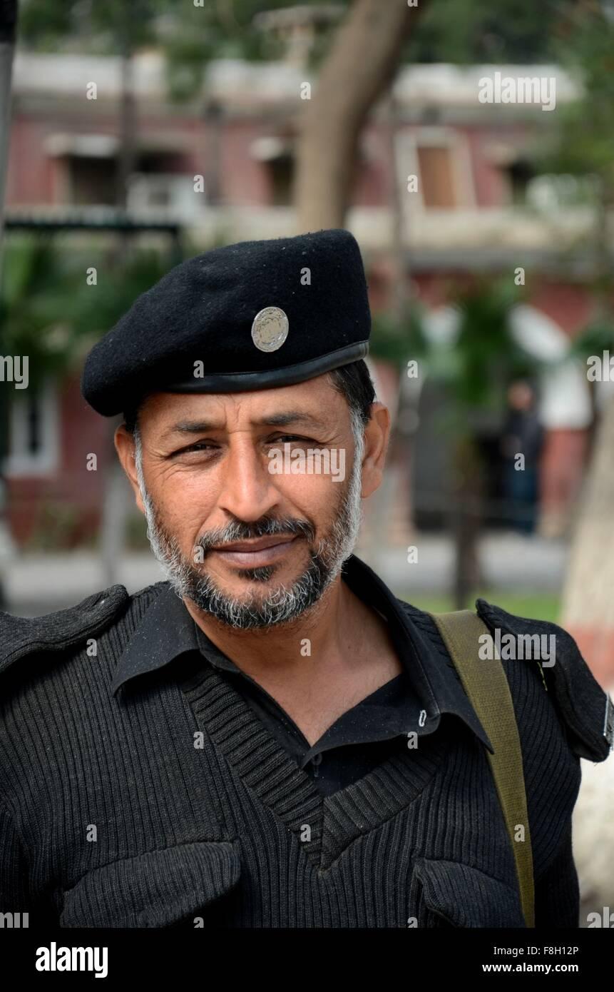 Pathan Pakistani policeman smiles for camera Peshawar Pakistan - Stock Image