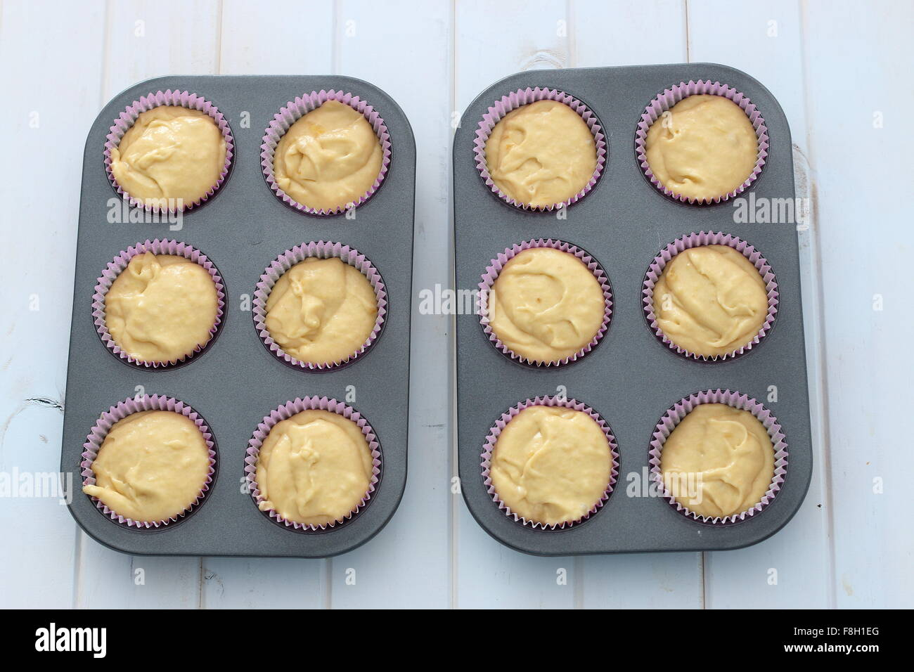 Uncooked cupcakes in cupcake tin - Stock Image