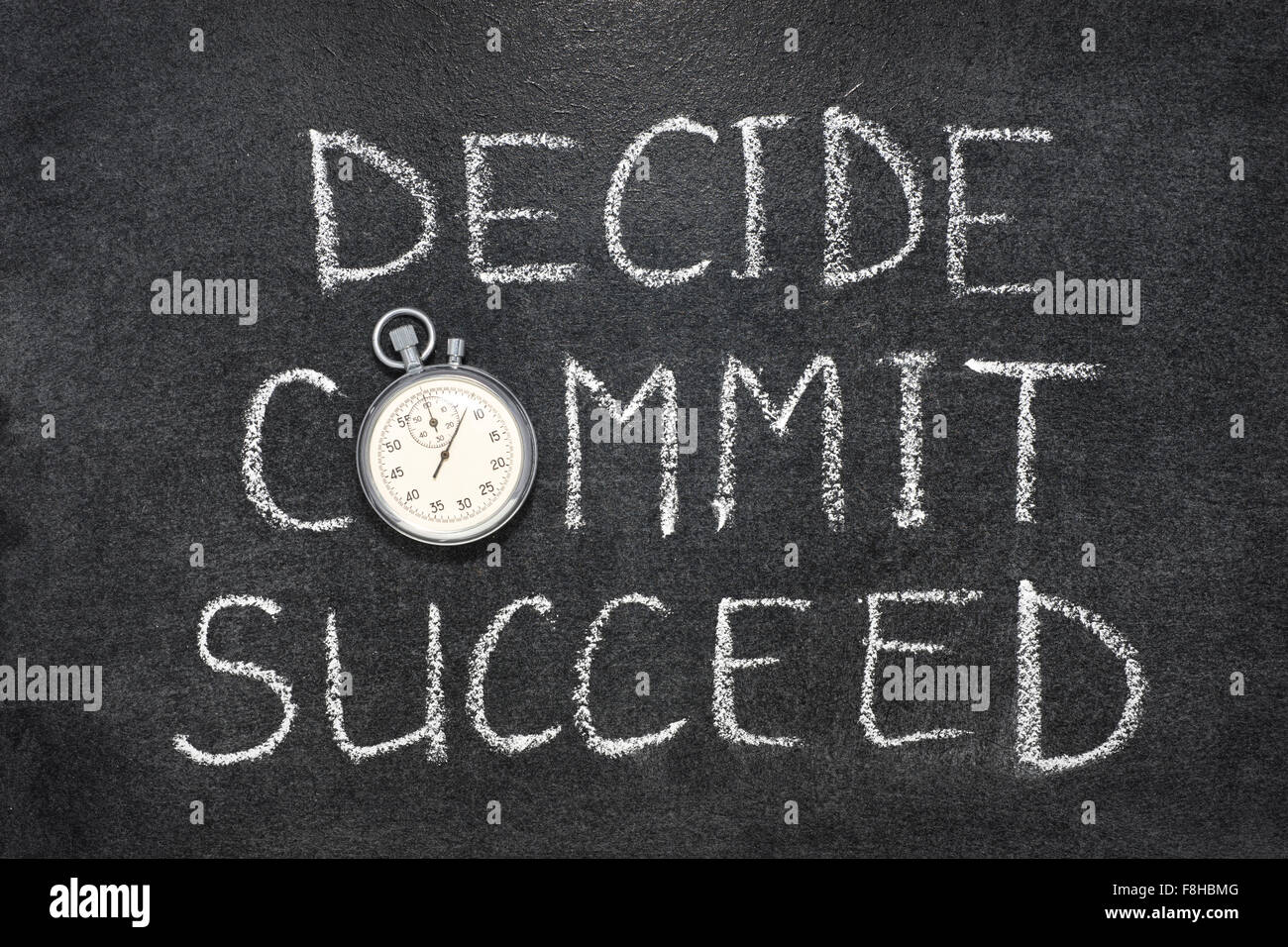 decide, commit, succeed words handwritten on chalkboard with vintage precise stopwatch used instead of O - Stock Image