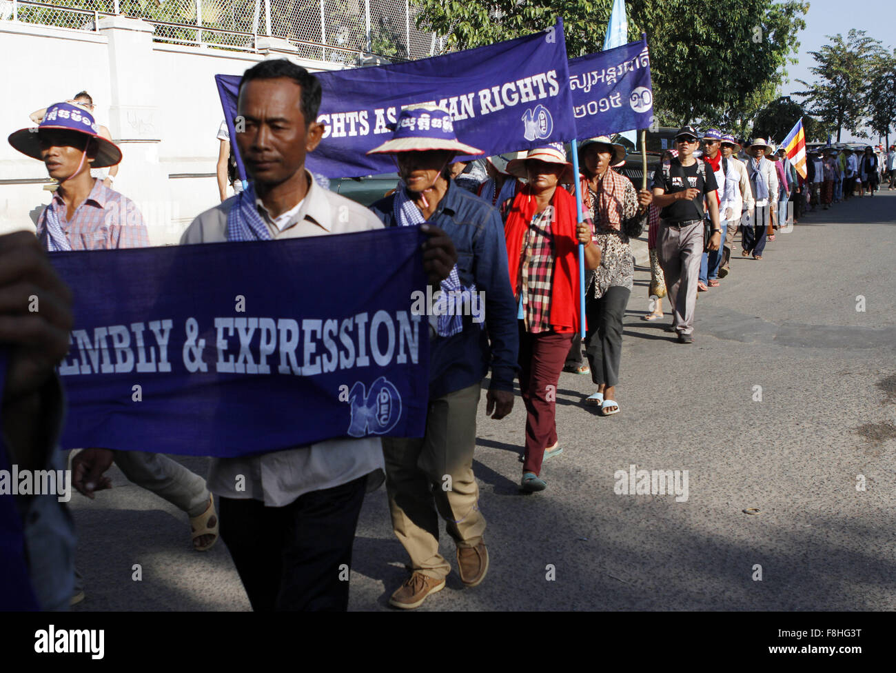 Phnom Penh, Cambodia. 10th Dec, 2015. Activists march through streets on the Human Rights Day in Phnom Penh, Cambodia, - Stock Image