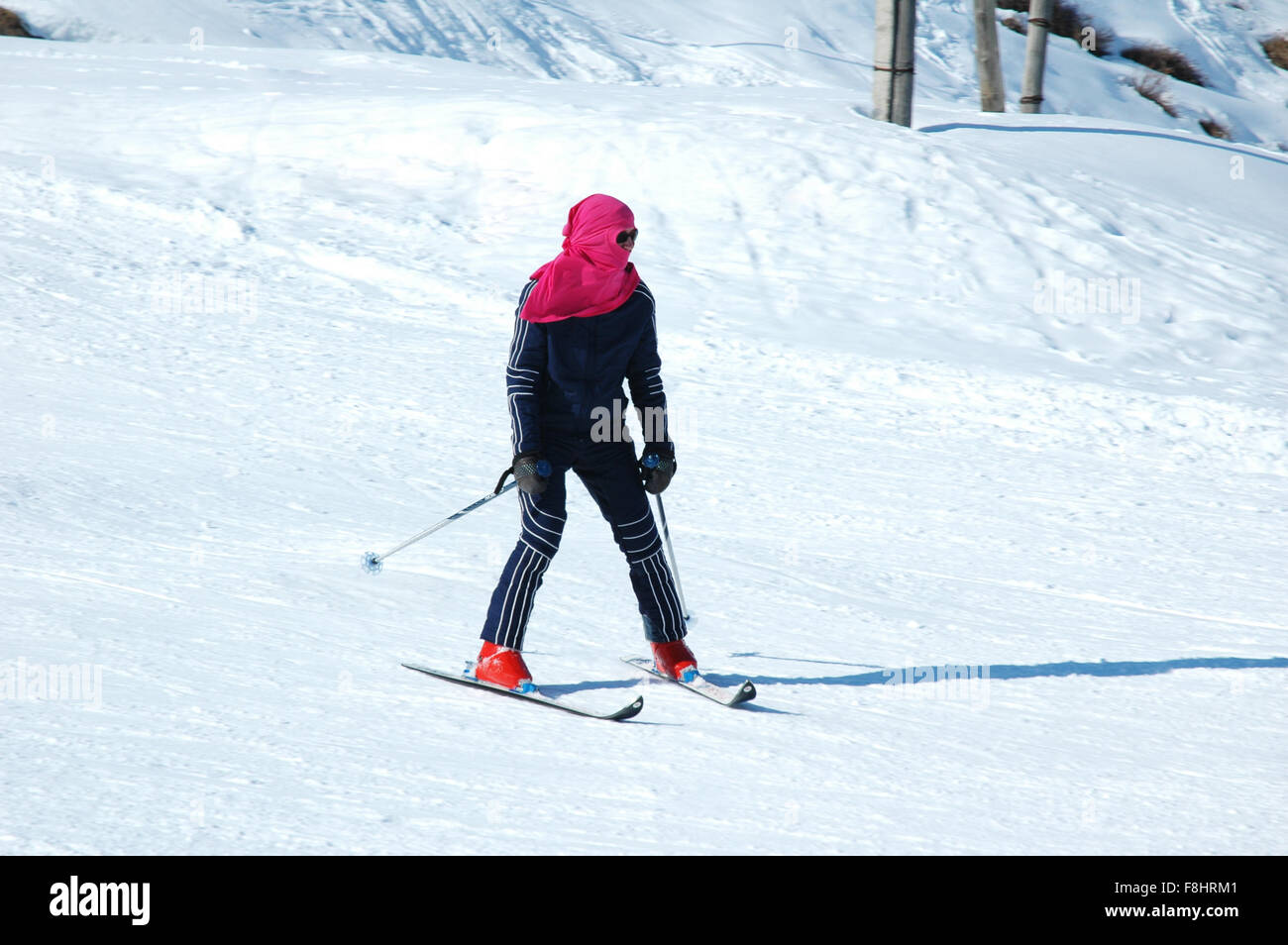 Skier on the snowy slope in winter - Stock Image