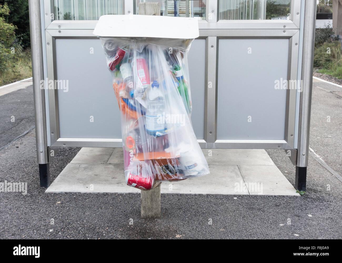 Plastic litter bin on railway station platform. England, UK - Stock Image
