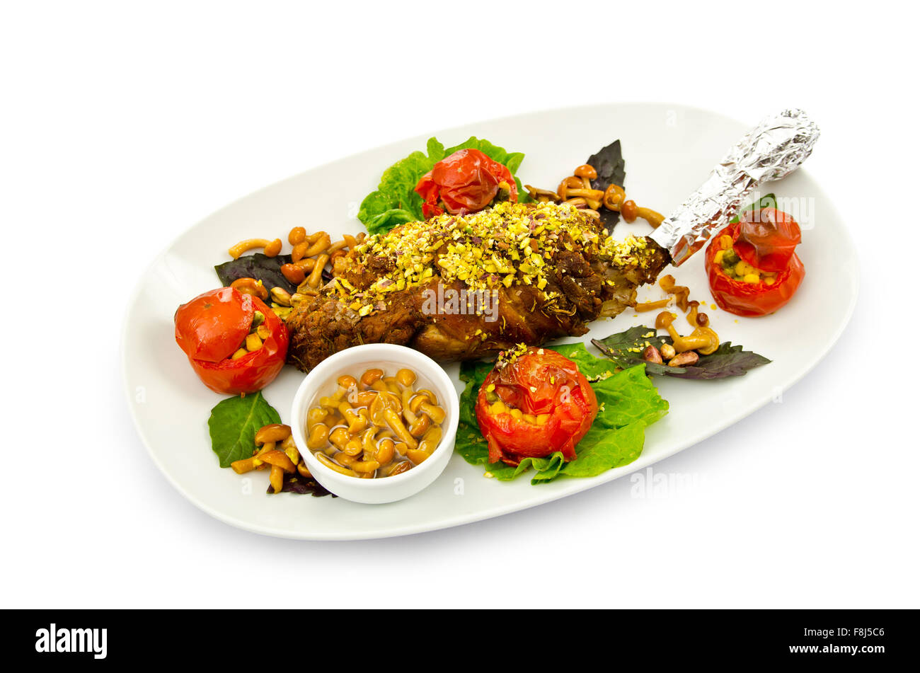 Lamb leg served in the plate - Stock Image