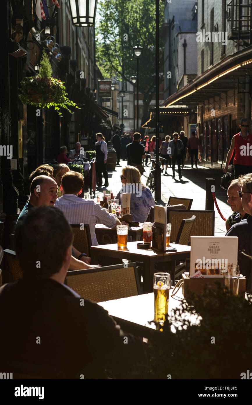 London theatre land, people drinking outside The Salisbury, a traditional London pub, in St Martin's Lane, London, - Stock Image