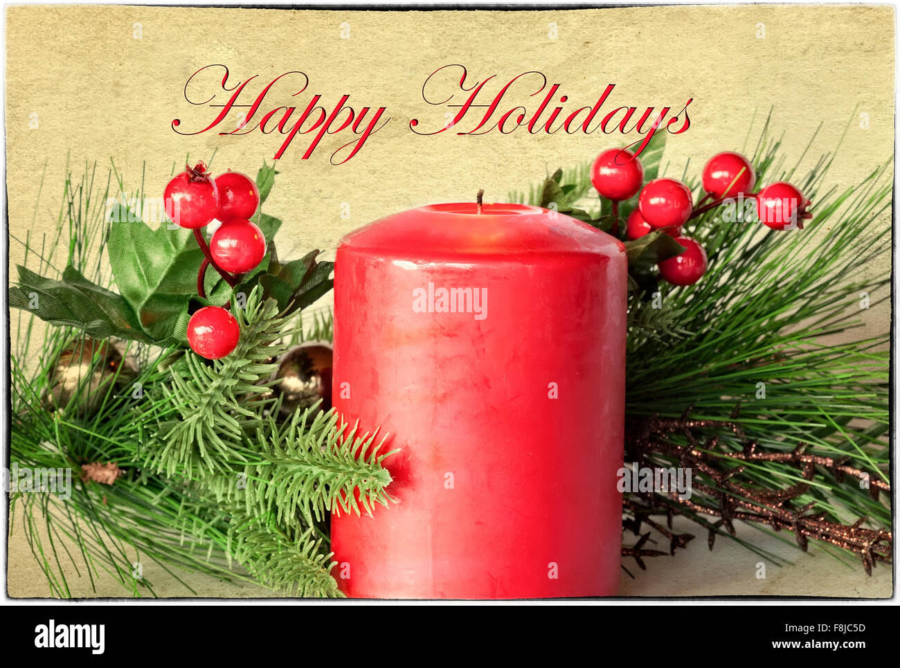 Christmas Greeting card with evergreen,  holly berries, red candle border and Happy Holidays text - Stock Image
