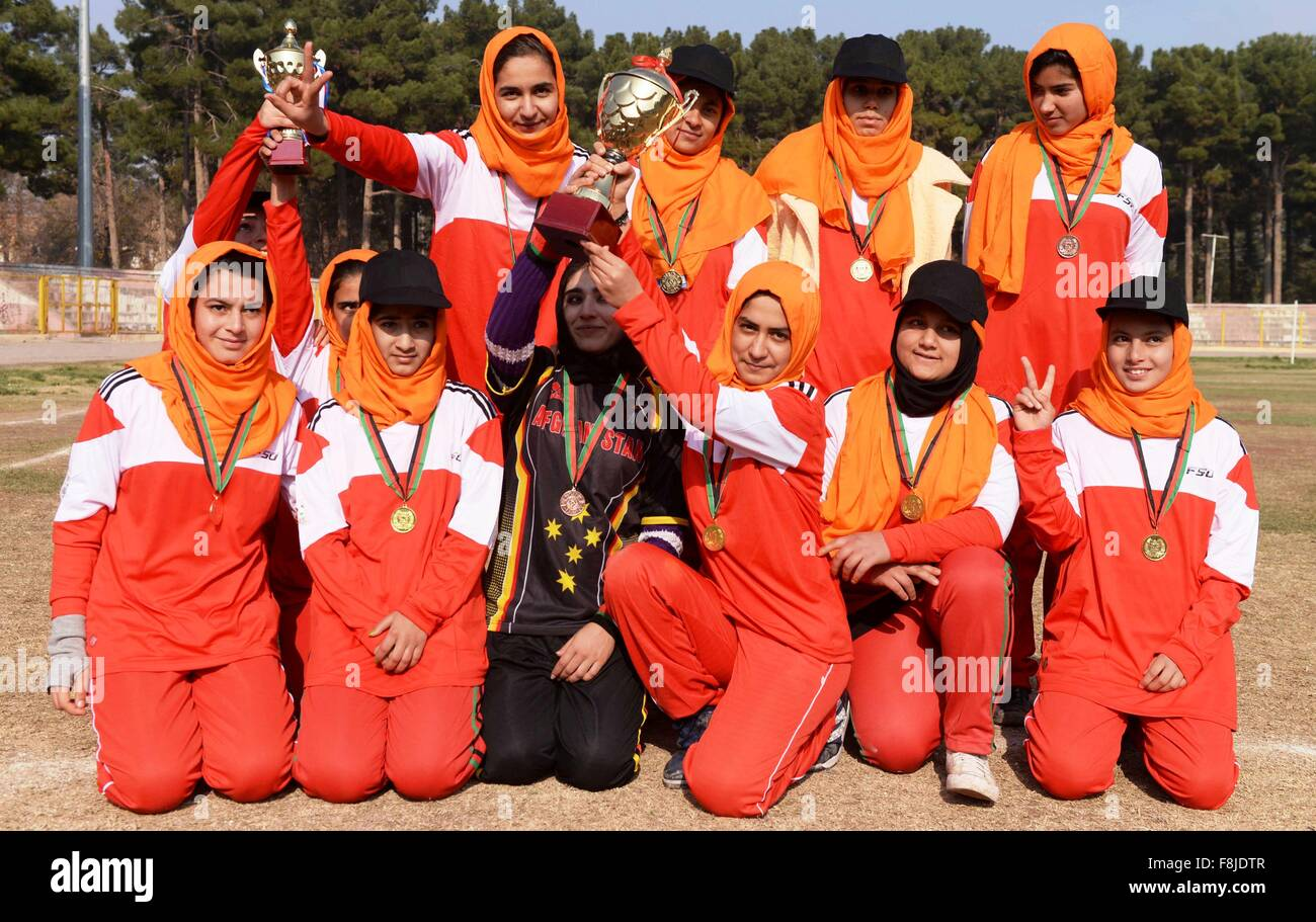 Herat, Afghanistan. 9th Dec, 2015. Afghan girls pose for a group photo after a cricket game at a stadium in Herat - Stock Image