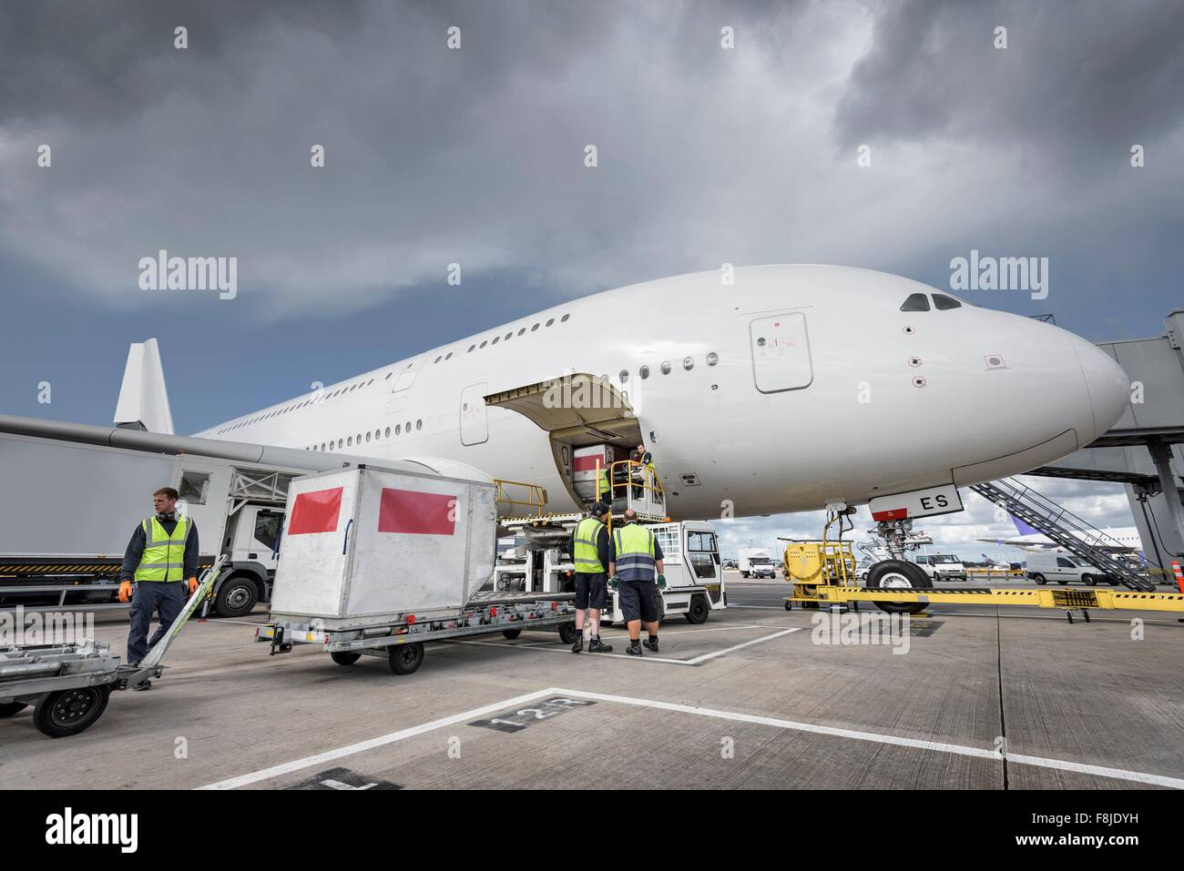 Ground crew loading freight onto A380 aircraft Stock Photo