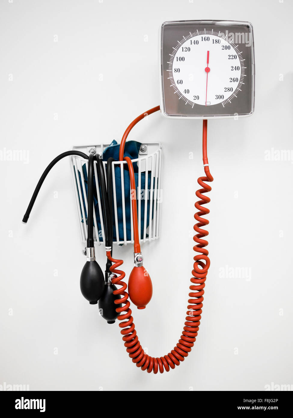 Sphygmomanometer Blood Pressure Gauge -Traditional bulb and dial sphygmomanometer blood pressure gauge on a hospital - Stock Image