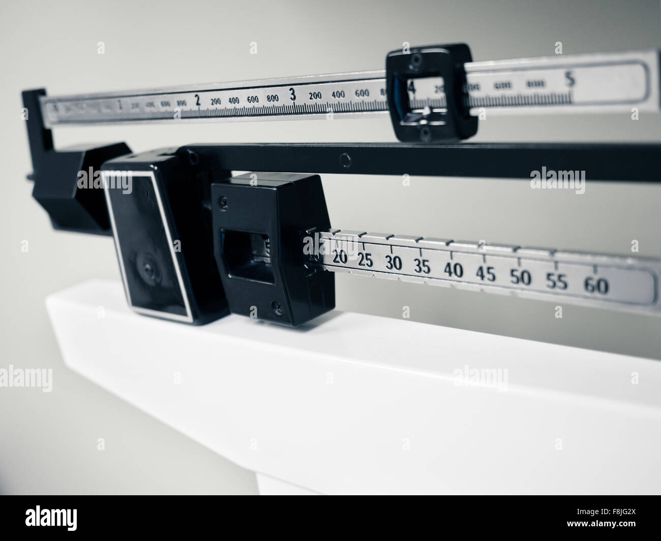 Doctor's Office Scale - Medical professional physician sliding balance weight scale at a doctor's office - Stock Image