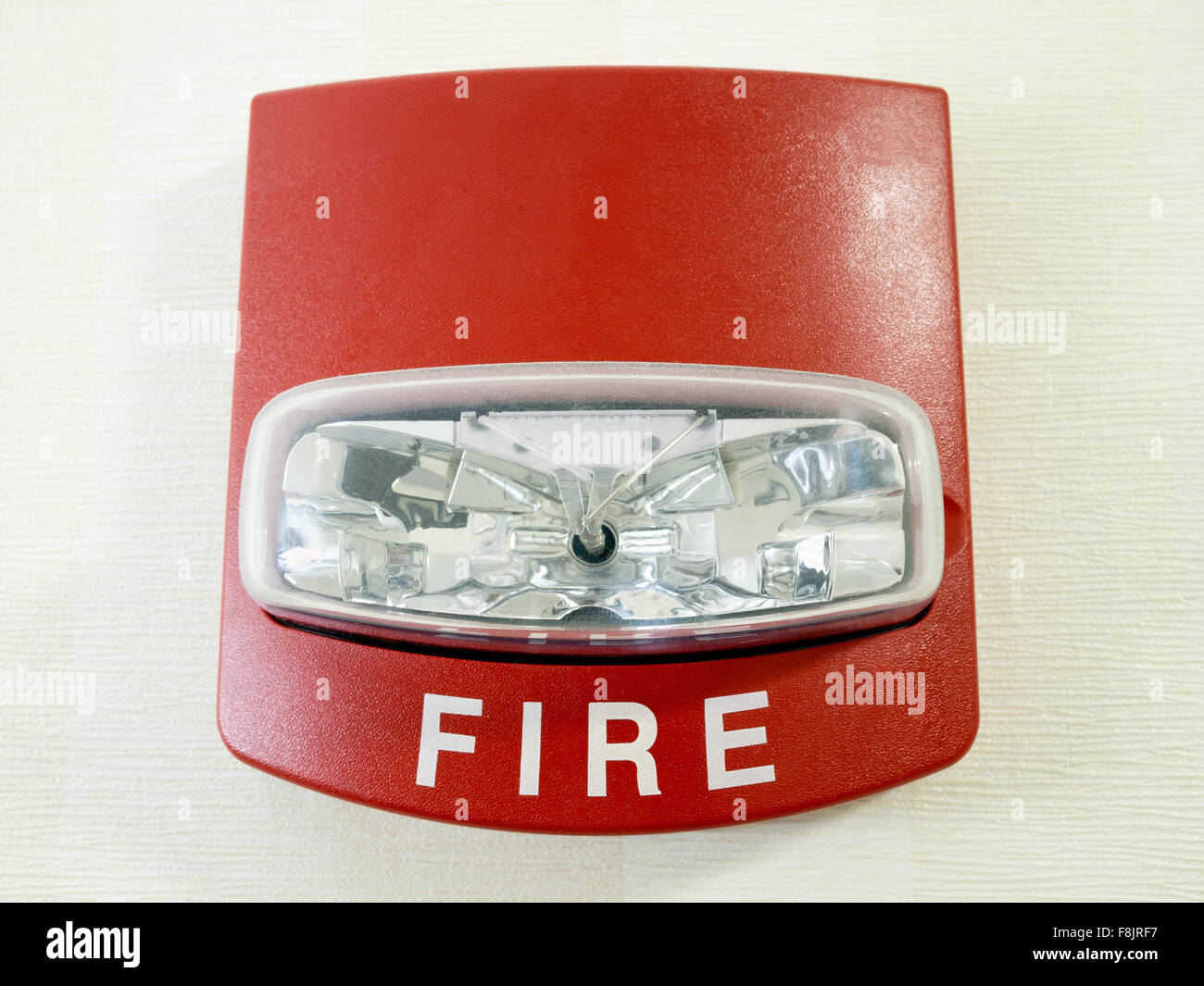 Red fire alarm strobe light smoke detector mounted on a wall as part red fire alarm strobe light smoke detector mounted on a wall as part of a commercial fire protection system aloadofball Images