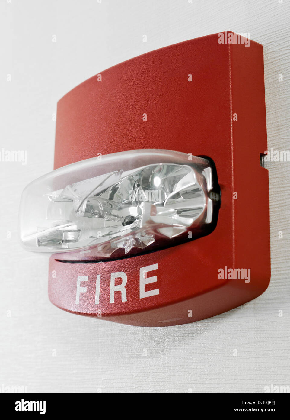 Red Fire Alarm With Strobe Light Mounted On A Wall As Part