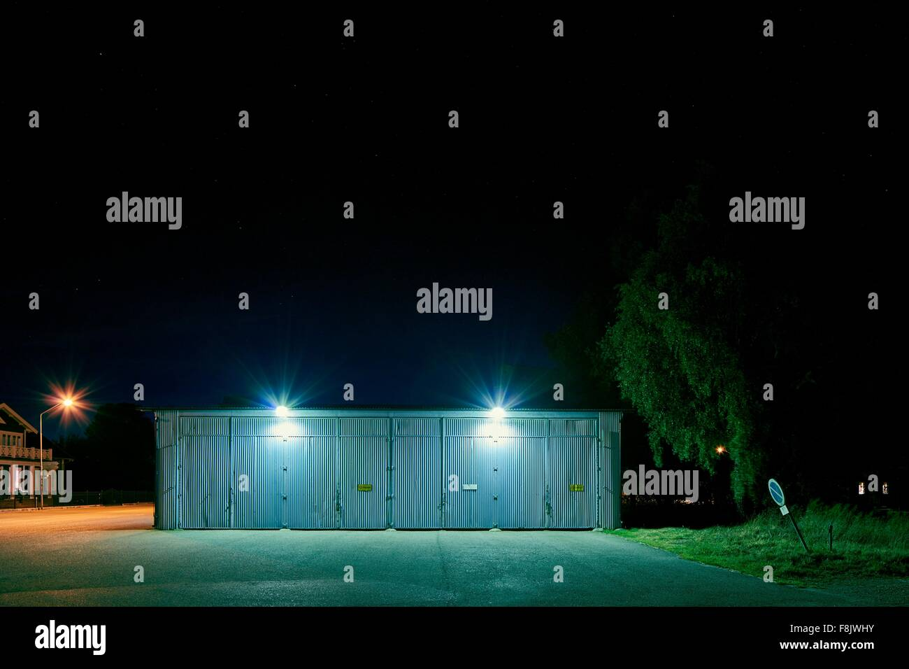 Garage with spotlights at night, Kalmar, Sweden - Stock Image