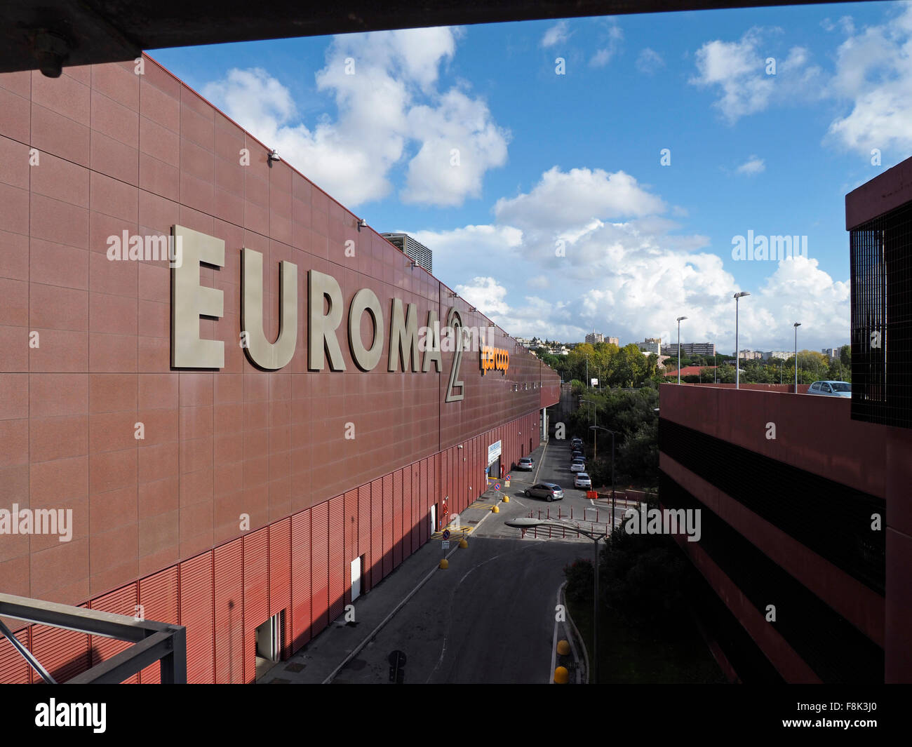 the huge Euroma2 luxury shopping mall in the EUR district of Rome, Italy - Stock Image