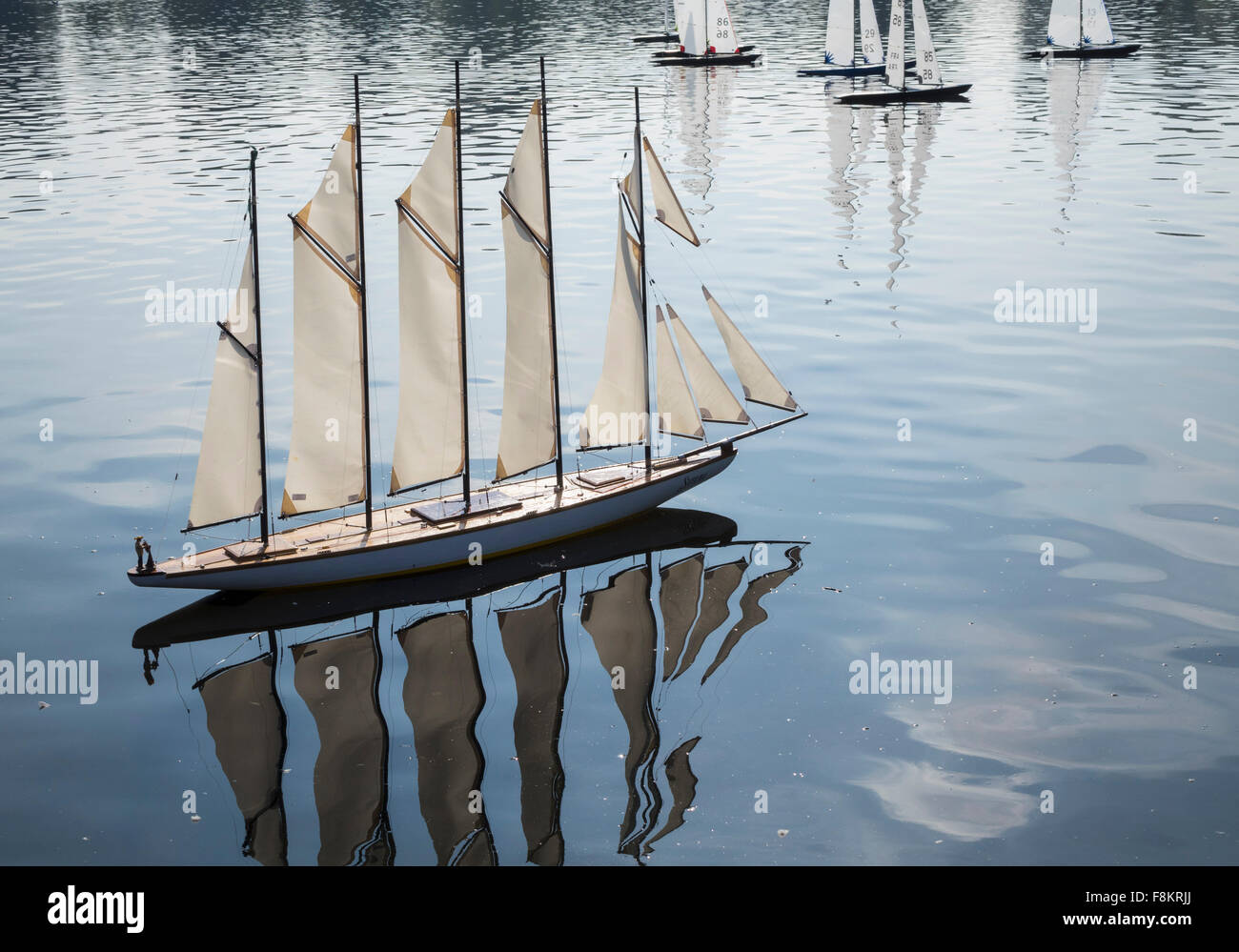 Model yacht sailing on a pond - Stock Image