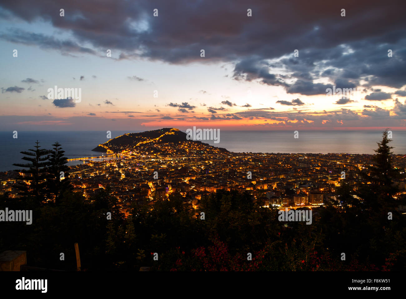 Night view of peninsula in Antalya, Alanya Castle with lighting in blue hours. - Stock Image