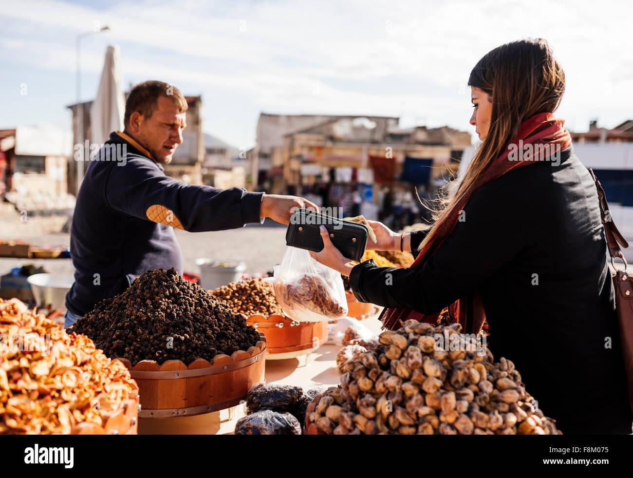 Young woman buying dried fruits, Uçhisar, Cappadocia, Anatolia Region, Turkey - Stock Image