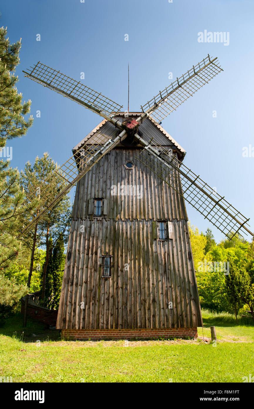 Wooden windmill Kozlak house building with blades in Mecmierz, Poland, Polish name drewniany wiatrak Kozlak, Wiatrak - Stock Image
