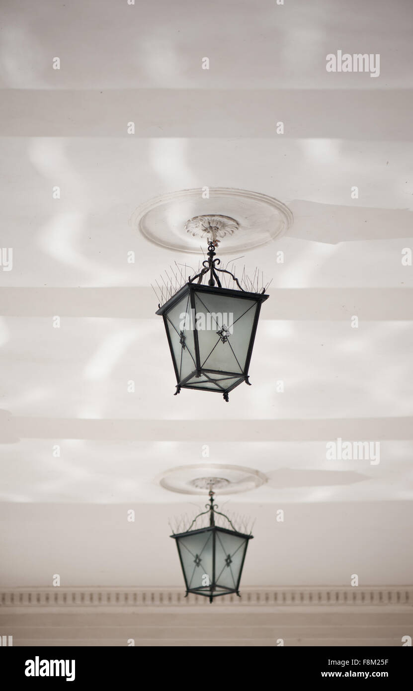Dangling decorative two lamps under ceiling, ornamental outside ...