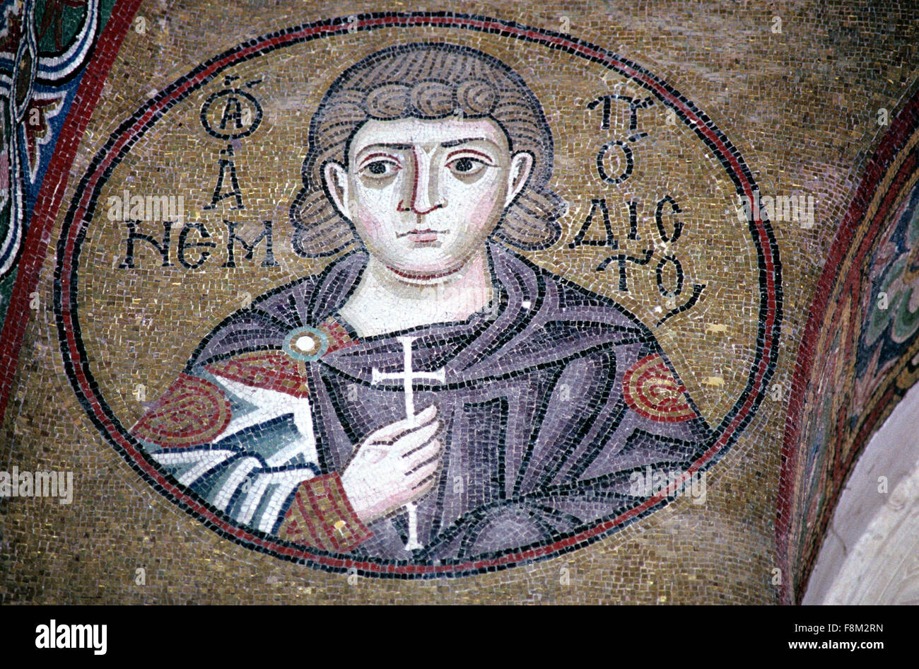 Byzantine Mosaic of the Greek Orthodox Saint and Martyr Saint Anembodistos Holding a Cross in the Byzantine Church - Stock Image