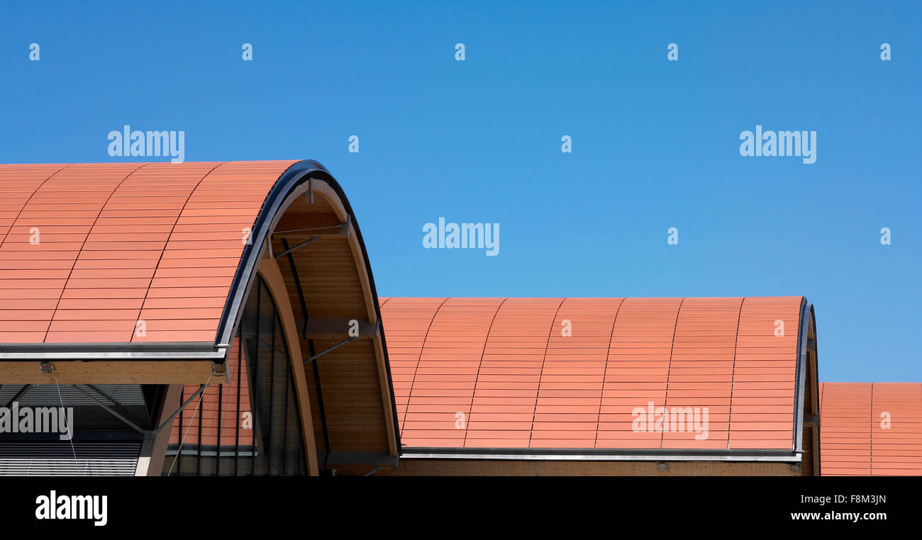 Curved orange roof with ceramic tiles. Blue sky Stock Photo ...
