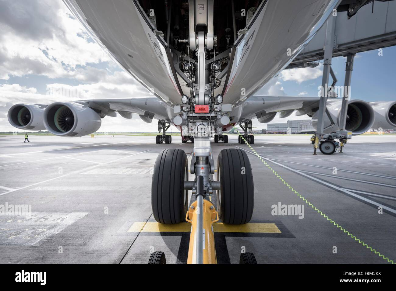Underside view of A380 aircraft about to taxi - Stock Image