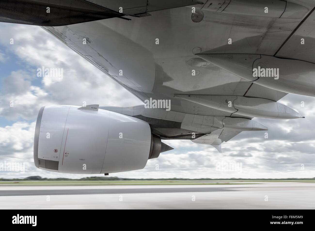 View of engine and wing on speeding A380 aircraft Stock Photo