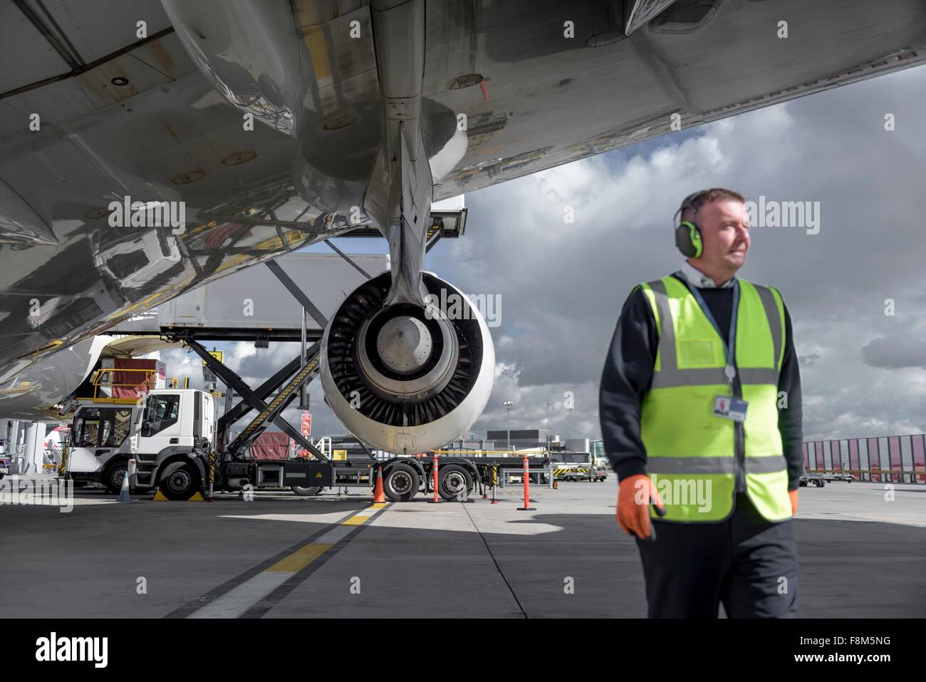 Ground crew engineer with A380 jet aircraft - Stock Image